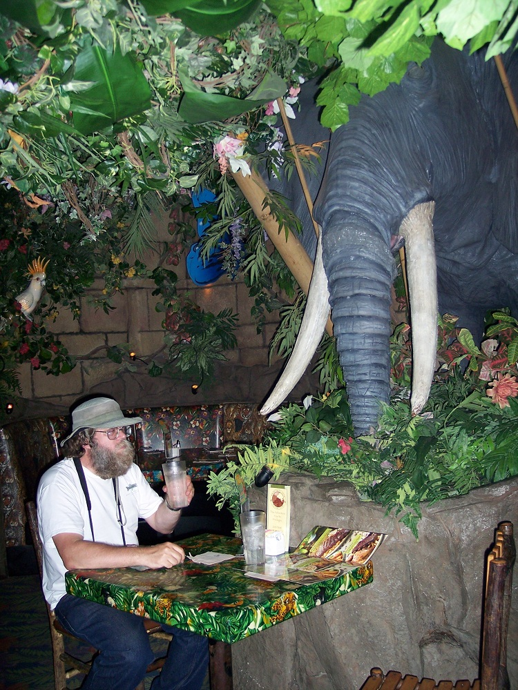 Chris Eating With Friend at the Rainforest Cafe